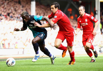 LIVERPOOL, ENGLAND - MARCH 03:  Bacary Sagna of Arsenal is closed down by Jose Enrique of Liverpool during the Barclays Premier League match between Liverpool and Arsenal at Anfield on March 3, 2012 in Liverpool, England.  (Photo by Clive Mason/Getty Imag