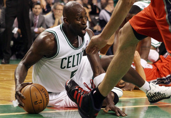 BOSTON, MA - MARCH 02:  Kevin Garnett #5 of the Boston Celtics grabs the loose ball in the second half against the New Jersey Nets on March 2, 2012 at TD Garden in Boston, Massachusetts. The Boston Celtics defeated the New Jersey Nets 107-94. NOTE TO USER