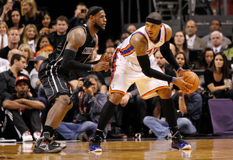 MIAMI, FL - FEBRUARY 23:  LeBron James #6 of the Miami Heat guards Carmelo Anthony #7 of the New York Knicks during a game at American Airlines Arena on February 23, 2012 in Miami, Florida. NOTE TO USER: User expressly acknowledges and agrees that, by dow