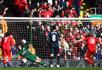 LIVERPOOL, ENGLAND - MARCH 03:  Wojciech Szczesny of Arsenal saves the penalty kick by Dirk Kuyt of Liverpool during the Barclays Premier League match between Liverpool and Arsenal at Anfield on March 3, 2012 in Liverpool, England.  (Photo by Clive Mason/
