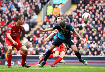 LIVERPOOL, ENGLAND - MARCH 03:  Robin van Persie of Arsenal heads the ball and scores the equalising goal during the Barclays Premier League match between Liverpool and Arsenal at Anfield on March 3, 2012 in Liverpool, England.  (Photo by Clive Mason/Gett