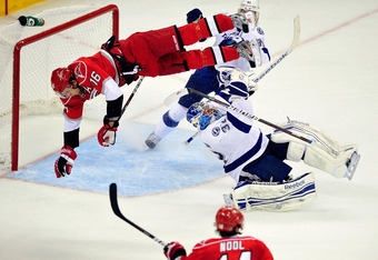 RALEIGH, NC - MARCH 03:  Brandon Sutter #16 of the Carolina Hurricanes draws a two minute penalty for roughing as he crashes into goaltender Mathieu Garon #32 of the Tampa Bay Lightning during overtime at the RBC Center on March 3, 2012 in Raleigh, North