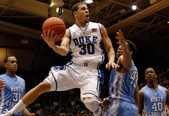 DURHAM, NC - MARCH 03:  Seth Curry #30 of the Duke Blue Devils drives to the basket on James Michael McAdoo #43 of the North Carolina Tar Heels during their game at Cameron Indoor Stadium on March 3, 2012 in Durham, North Carolina.  (Photo by Streeter Lec