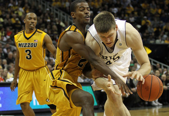 KANSAS CITY, MO - NOVEMBER 21:  Jack Cooley #45 of the Notre Dame Fighting Irish controls the ball as Kim English #24 of the Missouri Tigers defends during the Progressive CBE Classic game on November 21, 2011 at the Sprint Center in Kansas City, Missouri