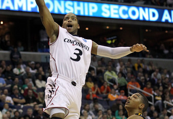 WASHINGTON - MARCH 17:  Dion Dixon #3 of the Cincinnati Bearcats puts up a shot against the Missouri Tigers during the second round of the 2011 NCAA men's basketball tournament at the Verizon Center on March 17, 2011 in Washington, DC.  (Photo by Nick Lah