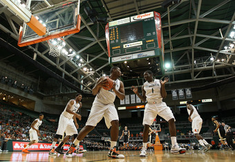 CORAL GABLES, FL - FEBRUARY 18:  Reggie Johnson #42 and Durand Scott #1 of the Miami (Fl) Hurricanes rebound during a game against the Wake Forest Demon Deacons at the BankUnited Center on February 18, 2012 in Coral Gables, Florida.  (Photo by Mike Ehrman