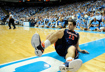 CHAPEL HILL, NC - FEBRUARY 11:  Sammy Zeglinski #13 of the Virginia Cavaliers skids down the baseline after being knocked down against by the North Carolina Tar Heels during play at the Dean Smith Center on February 11, 2012 in Chapel Hill, North Carolina