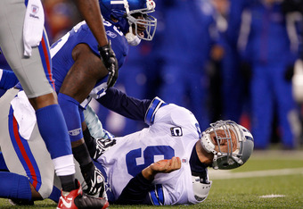 EAST RUTHERFORD, NJ - JANUARY 01:  Jason Pierre-Paul #90 of the New York Giants sacks Tony Romo #9 of the Dallas Cowboys in the first quarter at MetLife Stadium on January 1, 2012 in East Rutherford, New Jersey.  (Photo by Rich Schultz/Getty Images)