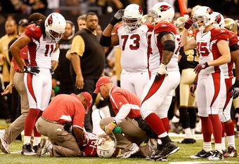 The NFL investigation began after accusations that the Saints had a bounty on the St. Louis Cardinals' QB Kurt Warner in this 2010 divisional playoff game.