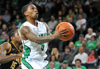 Senior Damier Pitts goes to the rim in his final home game for Marshall. (Photo courtesy of Rick Haye and Marshall University)