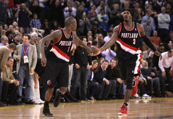 OAKLAND, CA - FEBRUARY 15:  Jamal Crawford #11 is congratulated by Gerald Wallace #3 of the Portland Trail Blazers after making a basket during their game against the Golden State Warriors at Oracle Arena on February 15, 2012 in Oakland, California. NOTE