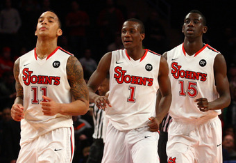 NEW YORK, NY - FEBRUARY 18:  (L-R) D'Angelo Harrison #11, Phil Greene #1 and Sir'Dominic Pointer #15 of the St. John's Red Storm runs up court against the UCLA Bruins at Madison Square Garden on February 18, 2012 in New York City.  (Photo by Chris Chamber