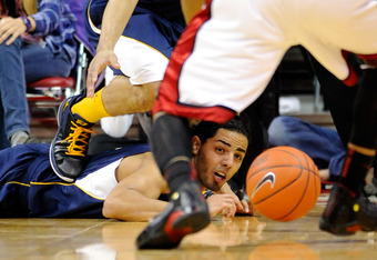 LAS VEGAS, NV - DECEMBER 23:  Jorge Gutierrez #2 of the California Golden Bears dives for a loose ball during a game against the UNLV Rebels at the Thomas & Mack Center December 23, 2011 in Las Vegas, Nevada. UNLV won 85-68.  (Photo by Ethan Miller/Getty