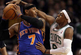 BOSTON, MA - MARCH 04:  Carmelo Anthony #7 of the New York Knicks tries to keep the ball from Rajon Rondo #9 of the Boston Celtics on March 4, 2012 at TD Garden in Boston, Massachusetts. NOTE TO USER: User expressly acknowledges and agrees that, by downlo