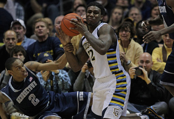 MILWAUKEE, WI - MARCH 03:  Jae Crowder #32 of the Marquette Golden Eagles grabs a loose ball away from Greg Whittington #2 of the Georgetown Hoyas at the Bradley Center on March 3, 2012 in Milwaukee, Wisconsin. Marquette defeated Georgetown 83-69.  (Photo
