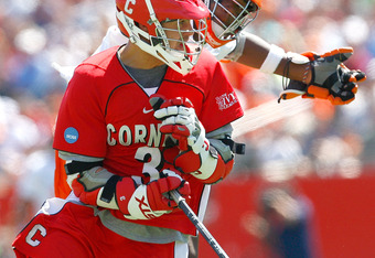 FOXBOROUGH, MA - MAY 25:  Jovan Miler #23 of the Syracuse Orange presses Rob Pannell #3 of the Cornell Big Red during the NCAA Division I Lacrosse Championship at Gillette Stadium May 25, 2009 in Foxborough, Massachusetts.  (Photo by Jim Rogash/Getty Imag