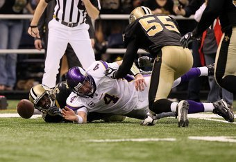 NEW ORLEANS - JANUARY 24:  Brett Favre #4 of the Minnesota Vikings attempts to recover a fumble which was comitted by a teammate against the New Orleans Saints during the NFC Championship Game at the Louisiana Superdome on January 24, 2010 in New Orleans,