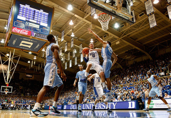 DURHAM, NC - MARCH 03:  Austin Rivers #0 of the Duke Blue Devils drives to the basket against the North Carolina Tar Heels during their game at Cameron Indoor Stadium on March 3, 2012 in Durham, North Carolina.  (Photo by Streeter Lecka/Getty Images)