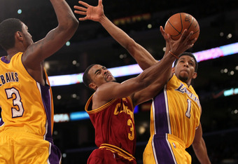 LOS ANGELES, CA - JANUARY 13:  Ramon Sessions #3 of the Cleveland Cavaliers goes up for a shot between Darius Morris #1 and Devin Ebanks #3 of the Los Angeles Lakers at Staples Center on January 13, 2012 in Los Angeles, California.  The Lakers won 97-92.
