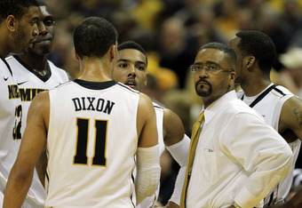 COLUMBIA, MO - FEBRUARY 21:  Head coach Frank Haith of the Missouri Tigers meets with players on the bench during a timeout in the game against the Kansas State Wildcats on February 21, 2012 at Mizzou Arena in Columbia, Missouri.  (Photo by Jamie Squire/G