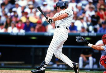 24 Jul 1999: Dante Bichette #10 of the Colorado Rockies swings at the ball during the game against the St. Louis Cardinals at Coors Field in Denver, Colorado. The Cardinals defeated the Rockies 10-2.