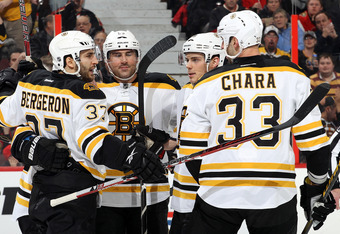 OTTAWA, CANADA - FEBRUARY 25: Patrice Bergeron #37 of the Boston Bruins celebrates his first period goal with teammates Zdeno Chara #33 and Tyler Seguin #19 during an NHL game against the Ottawa Senators at Scotiabank Place on February 25, 2012 in Ottawa,