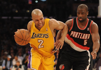 LOS ANGELES, CA - FEBRUARY 20:  Derek Fisher #2 of the Los Angeles Lakers fends off Raymond Felton #5 of the Portland Trail Blazers as he dribbles to the basket during the first half at Staples Center on February 20, 2012 in Los Angeles, California.  NOTE
