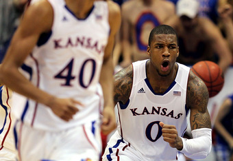 LAWRENCE, KS - FEBRUARY 25:  Thomas Robinson #0 of the Kansas Jayhawks reacts after scoring as the Jayhawks defeated the Missouri Tigers 87-86 to win the game on February 25, 2012 at Allen Fieldhouse in Lawrence, Kansas.  (Photo by Jamie Squire/Getty Imag