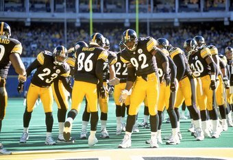 3 Dec 2000:  Hines Ward #86 of the Pittsburgh Steelers runs through the lineup as he slaps hands with Jason Gildon #92 before the game against the Oakland Raiders at the Three Rivers Stadium in Pittsburgh, Pennsylvania. The Steelers defeated the Raiders 2