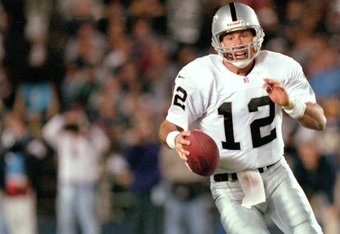 29 Oct 2000:  Rich Gannon #12 of the Oakland Raiders runs with the ball during the game against the San Diego Chargers at Qualcomm Stadium in San Diego, California. The Raiders defeated the Chargers 18-15.Mandatory Credit: Jeff Gross  /Allsport