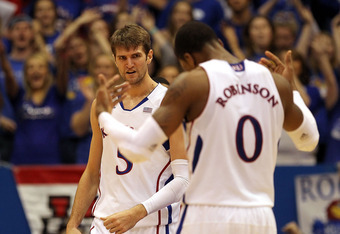 LAWRENCE, KS - FEBRUARY 01:  Jeff Withey #5 of the Kansas Jayhawks reacts toward  Thomas Robinson #0 after scoring during the game against the Oklahoma Sooners on February 1, 2012 at Allen Fieldhouse in Lawrence, Kansas.  (Photo by Jamie Squire/Getty Imag