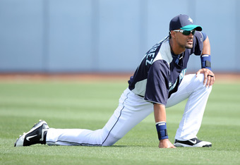 PEORIA, AZ - MARCH 01:  Franklin Gutierrez #21 of the Seattle Mariners warms up before the game against the Texas Rangers during spring training at Peoria Stadium on March 1, 2011 in Peoria, Arizona.  (Photo by Harry How/Getty Images)