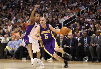 PHOENIX, AZ - FEBRUARY 19:  Steve Blake #5 of the Los Angeles Lakers handles the ball against the Phoenix Suns during the NBA game at US Airways Center on February 19, 2012 in Phoenix, Arizona.  The Suns defeated the Lakers 102-90.  NOTE TO USER: User exp