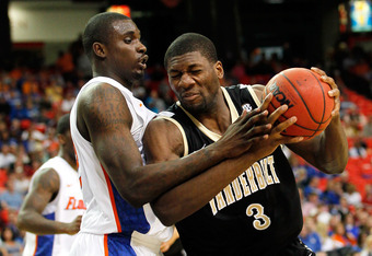 ATLANTA, GA - MARCH 12:  Festus Ezeli #3 of the Vanderbilt Commodores drives against Vernon Macklin #32 of the Florida Gators during the semifinals of the SEC Men's Basketball Tournament at Georgia Dome on March 12, 2011 in Atlanta, Georgia.  (Photo by Ke