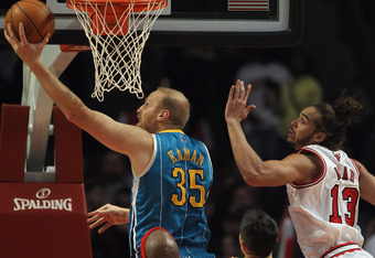 CHICAGO, IL - FEBRUARY 28: Chris Kaman #35 of the New Orleans Hornets puts up a shot past Joakim Noah #13 of the Chicago Bulls at the United Center on February 28, 2012 in Chicago, Illinois. NOTE TO USER: User expressly acknowledges and agrees that, by do