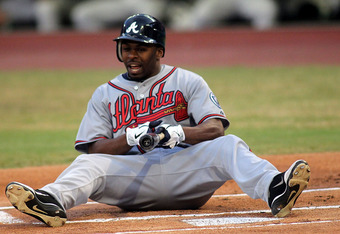 MIAMI GARDENS, FL - SEPTEMBER 20: Michael Bourn #24 of the Atlanta Braves sits at home plate against the Florida Marlins at Sun Life Stadium on September 20, 2011 in Miami Gardens, Florida.  (Photo by Marc Serota/Getty Images)