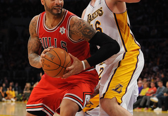 LOS ANGELES, CA - DECEMBER 25:  Carlos Boozer #5 of the Chicago Bulls drives against Pao Gasol #16 of the Los Angeles Lakers at Staples Center on December 25, 2011 in Los Angeles, California.  NOTE TO USER: User expressly acknowledges and agrees that, by