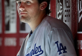 PHOENIX, AZ - AUGUST 06:  Starting pitcher Nathan Eovaldi #50 of the Los Angeles Dodgers sits in the dugout before the Major League Baseball game against the Arizona Diamondbacks at Chase Field on August 6, 2011 in Phoenix, Arizona. The Dodgers defeated t