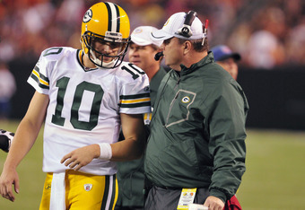 CLEVELAND, OH - AUGUST 13: Quarterback Matt Flynn #10 talks with head coach Mike McCarthy of the Green Bay Packers during the second quarter against the Cleveland Browns at Cleveland Browns Stadium on August 13, 2011 in Cleveland, Ohio. (Photo by Jason Mi