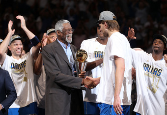 MIAMI, FL - JUNE 12:  Bill Russell presents the Bill Russell Finals MVP trophy to Finals MVP Dirk Nowitzki #41 of the Dallas Mavericks after the Mavericks won 105-95 in Game Six of the 2011 NBA Finals at American Airlines Arena on June 12, 2011 in Miami,