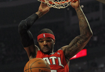 CHICAGO, IL - FEBRUARY 20:  Josh Smith #5 of the Atlanta Hawks dunks the ball over Joakim Naoh #13 of the Chicago Bulls at the United Center on February 20, 2012 in Chicago, Illinois. The Bulls defeated the Hawks 90-79. NOTE TO USER: User expressly acknow