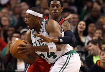 BOSTON, MA - JANUARY 04:  Paul Pierce #34 of the Boston Celtics heads to the net as MarShon Brooks #9 of the New Jersey Nets defends on January 4, 2012 at TD Garden in Boston, Massachusetts. The Boston Celtics defeated the New Jersey Nets 89-70. NOTE TO U