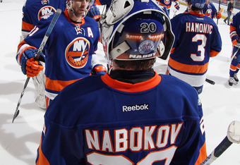 UNIONDALE, NY - DECEMBER 31: New York Islanders line up to congratulate Evgeni Nabokov #20 following a 4-1 victory over the Edmonton Oilers at the Nassau Veterans Memorial Coliseum on December 31, 2011 in Uniondale, New York.  (Photo by Bruce Bennett/Gett