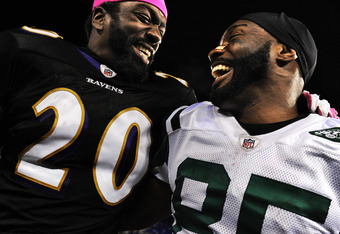 BALTIMORE, MD - OCTOBER 2: Safety Ed Reed #20 of the Baltimore Ravens and wide receiver Derrick Mason #85 of the New York Jets, who is a former teammate, share a laugh after the NFL football game at M&T Bank Stadium on October 2, 2011 in Baltimore, Maryla