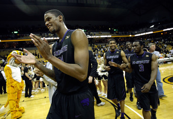 COLUMBIA, MO - FEBRUARY 21:  Jordan Henriguez #21 of the Kansas State Wildcats celebrates after the Wildcats defeated the Missouri Tigers to win the game on February 21, 2012 at Mizzou Arena in Columbia, Missouri.  (Photo by Jamie Squire/Getty Images)