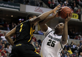 INDIANAPOLIS, IN - MARCH 10:  Derrick Nix #25 of the Michigan State Spartans attempts a shot against Melsahn Basabe #1 of the Iowa Hawkeyes during the first round of the 2011 Big Ten Men's Basketball Tournament at Conseco Fieldhouse on March 10, 2011 in I
