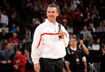 COLUMBUS, OH - JANUARY 15:  Head football coach Urban Meyer of the Ohio State Buckeyes is introduced to the crowd at halftime of the basketball game between the Indiana Hoosiers and the Ohio State Buckeyes on January 15, 2012 at Value City Arena in Columb