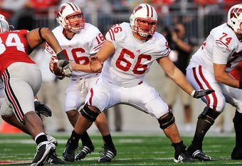 COLUMBUS, OH - OCTOBER 10:  Offensive lineman Peter Konz #66 of the Wisconsin Badgers blocks against the Ohio State Buckeyes at Ohio Stadium on October 10, 2009 in Columbus, Ohio.  (Photo by Jamie Sabau/Getty Images)