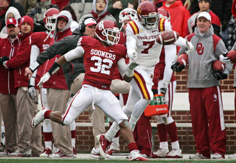 NORMAN, OK - NOVEMBER 26:  Wide receiver Darius Reynolds #7 of the Iowa State Cyclones reaches for a pass in front of Cornerback Jamell Fleming #32 of the Oklahoma Sooners during the second half November 26, 2011 at Gaylord Family-Oklahoma Memorial Stadiu
