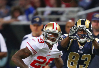 ST. LOUIS, MO - JANUARY 1: Brandon Lloyd #83 of the St. Louis Rams looks to make a catch against Chris Culliver #29 of the San Francisco 49ers at the Edward Jones Dome on January 1, 2012 in St. Louis, Missouri.  The 49ers beat the Rams 34-27.  (Photo by D